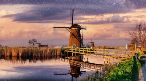 Dutch mill at night in Holland Netherlands