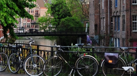 Bicycles by the river in Bruges
